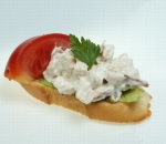 Tapas with chicken fillet in mayonnaise and pesto, tomato, green salad