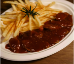 Curry wurst with crispy fries