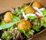 Quinoa meatballs with cheese and a mix of Philadelphia salads