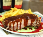 Pork ribs in oven with BBQ sauce espresso and fries
