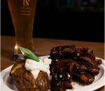 Pork ribs with baked potato with cheese mousse