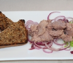 Cod liver with bread of spelled and red onion