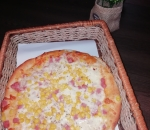 Small pizza with ham and corn