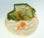 Bite with fresh cucumber and milk mousse