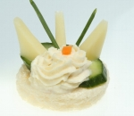 Bites with yellow cheese, fresh cucumber and milk mousse