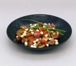 Pink tomatoes with mozzarella pearls