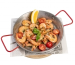 Shrimp on a frying pan with garlic and dill
