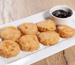 Breaded smoked cheese with blueberry jam