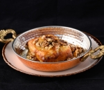 Cheese baked in golden peel with honey and nuts