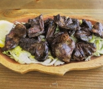 Grilled duck hearts in butter and garlic