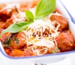 Mini meatballs with tomato sauce and basil