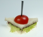 Mini sandwich with olive paste, green salad and cherry tomato