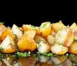 Steamed potatoes with dill and garlic