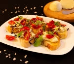 Bruschettes with fresh mozzarella, cherry tomatoes and balsamic reduction